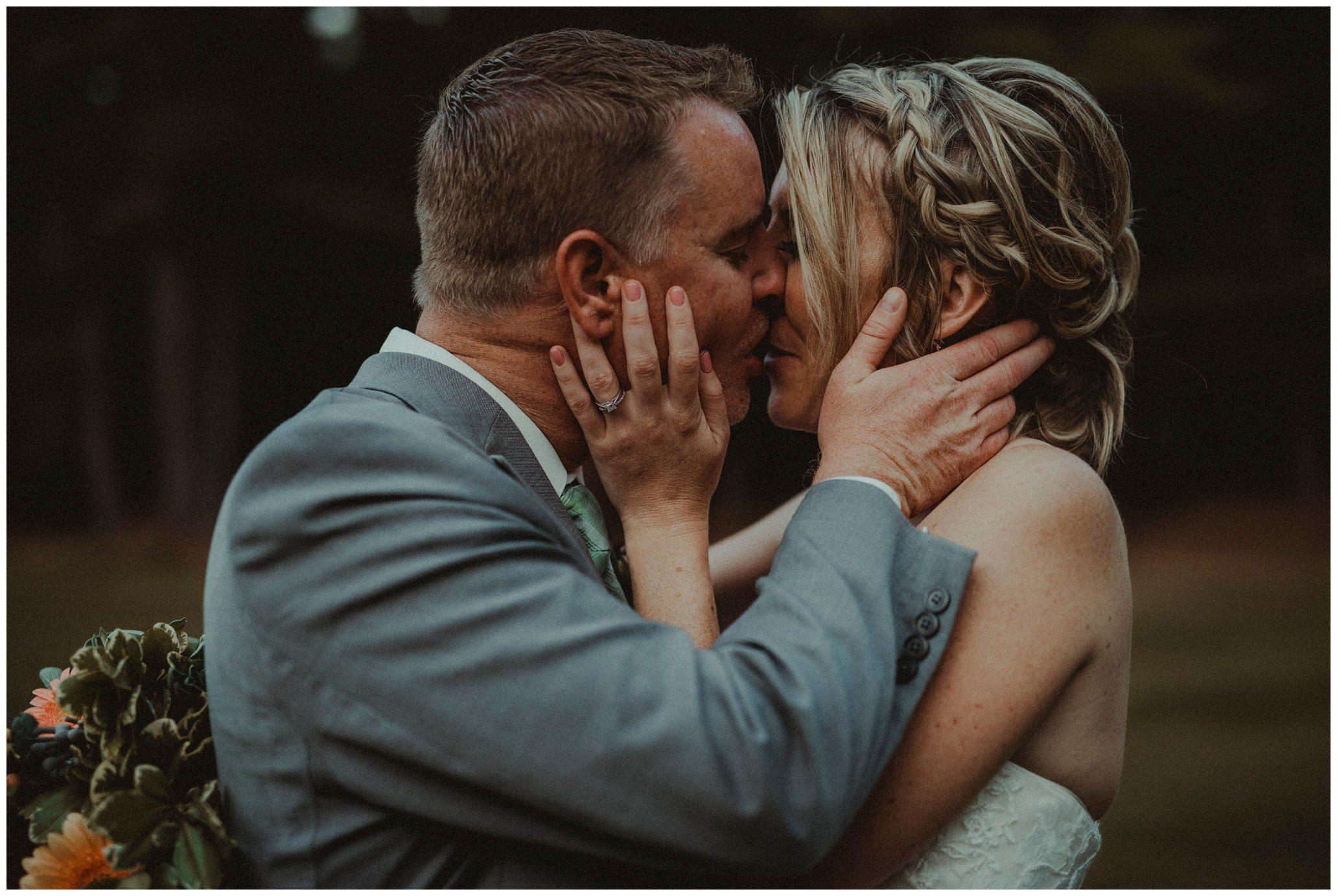 Pontiac wedding groom + bride kiss
