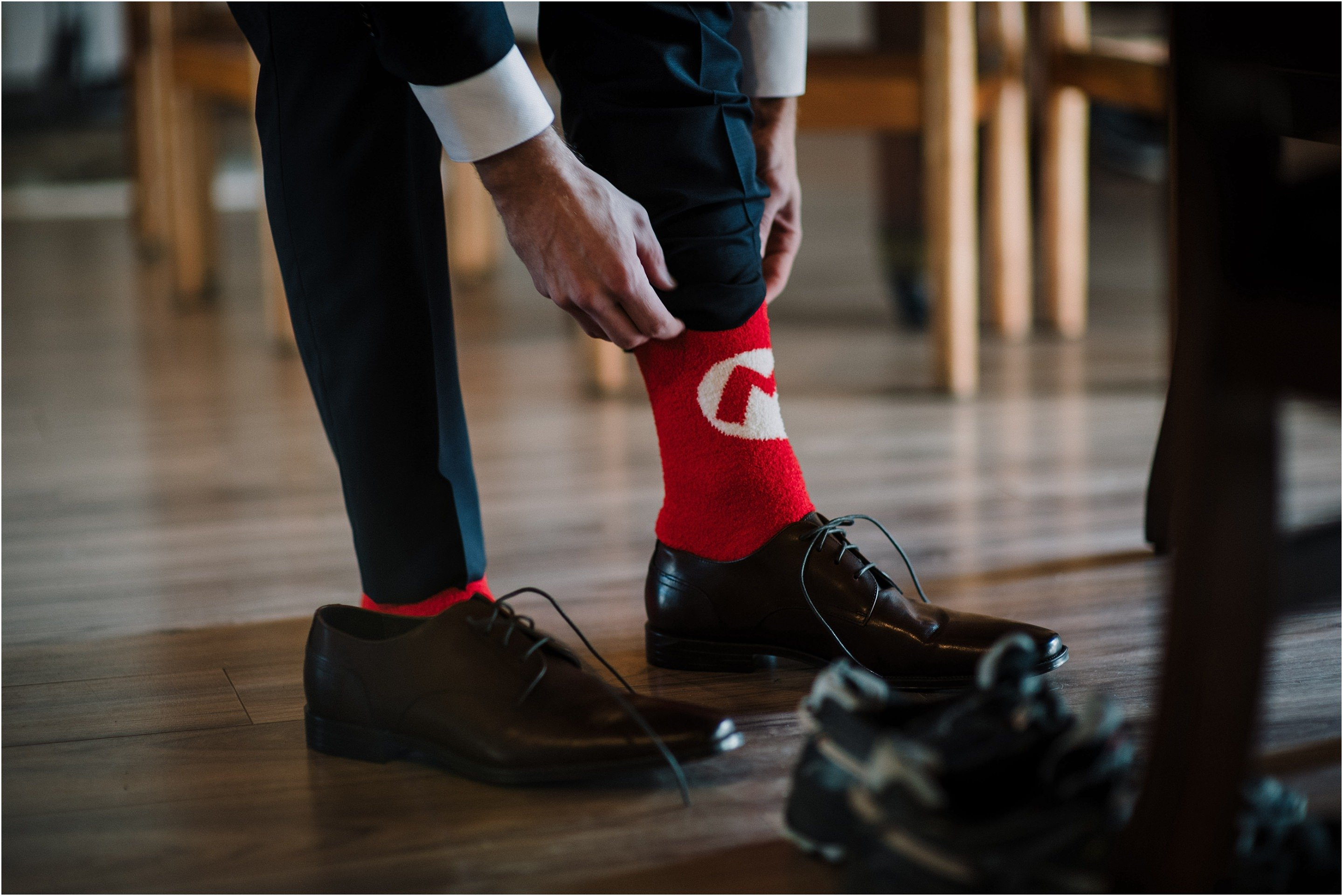 Mario socks for this stylish groom on his wedding day at Stonefields in Ottawa. Photo by Cindy Lottes Photography
