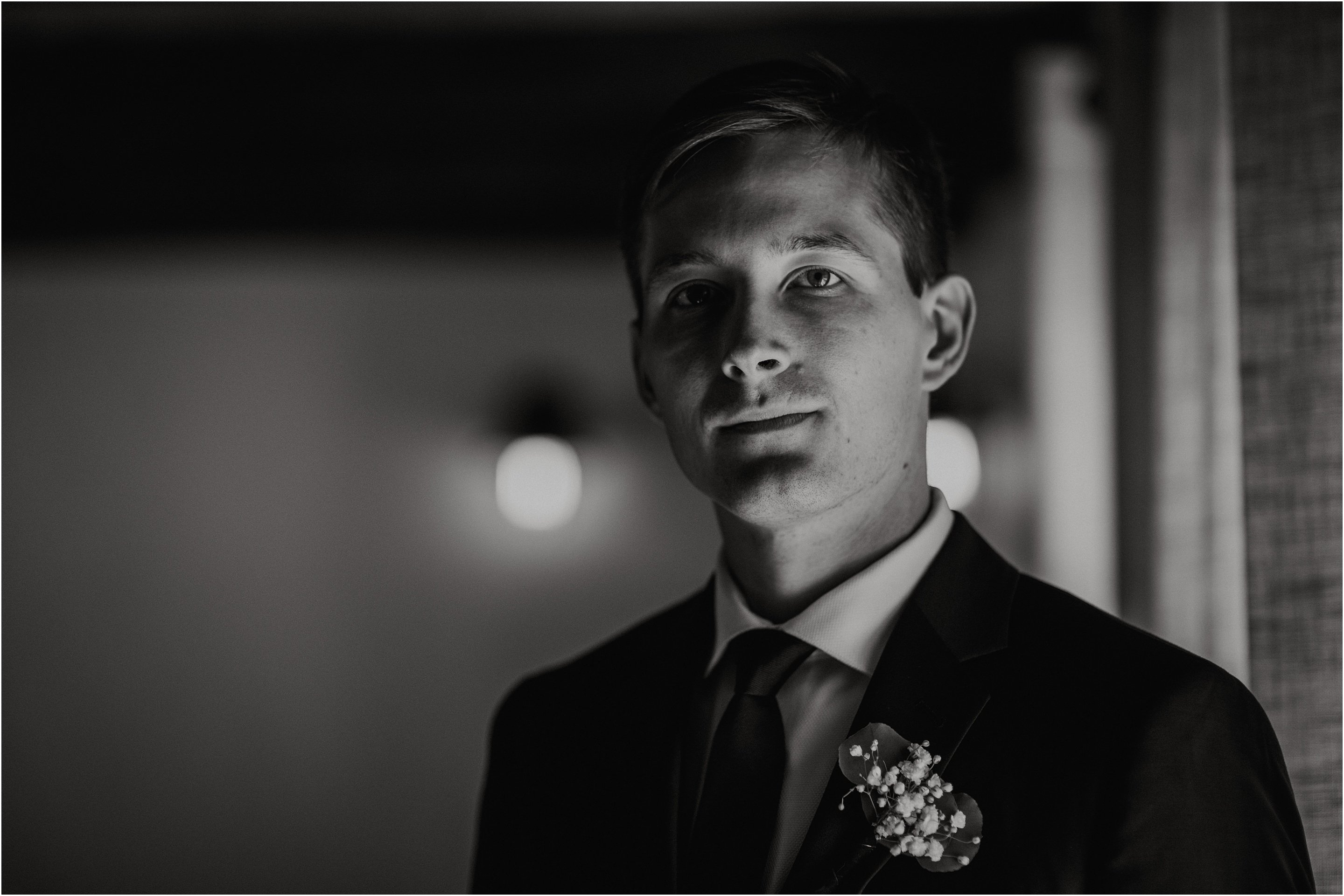 A moody portrait of the groom by Cindy Lottes Photography