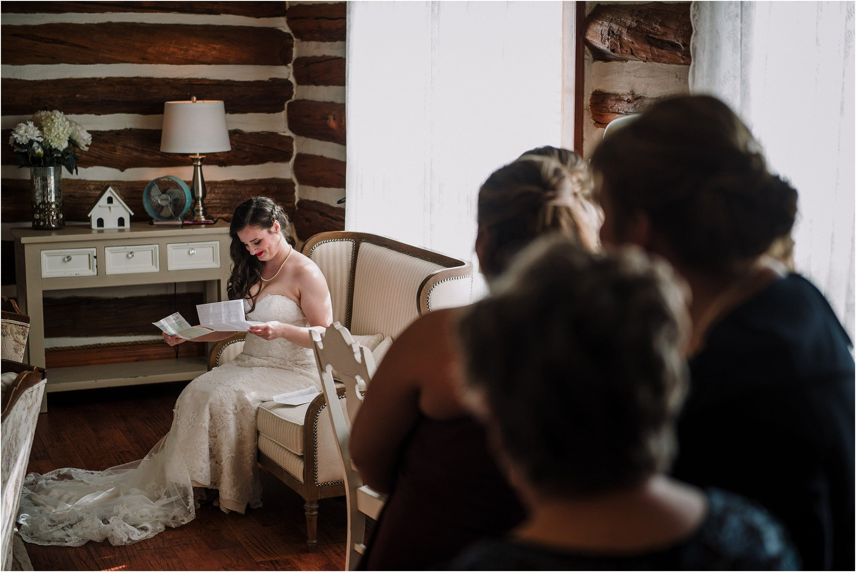 The bride reading a love note from her groom on her wedding day. Photo by Cindy Lottes Photography