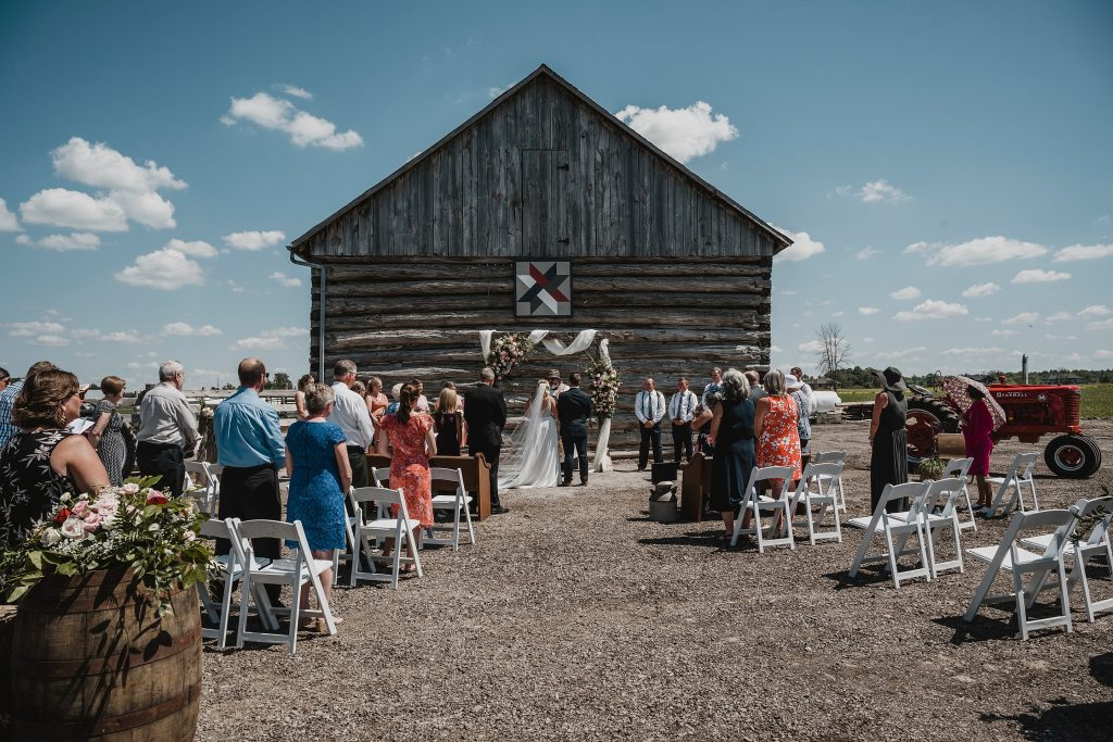 backyard farm wedding in front of the barn in Dunrobin Ontario