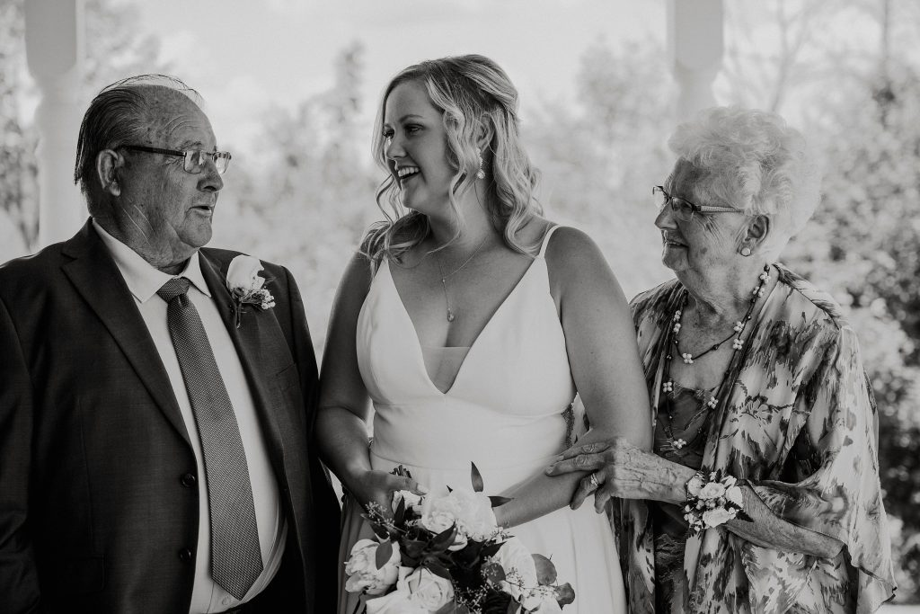 bride laughing with her grandparents