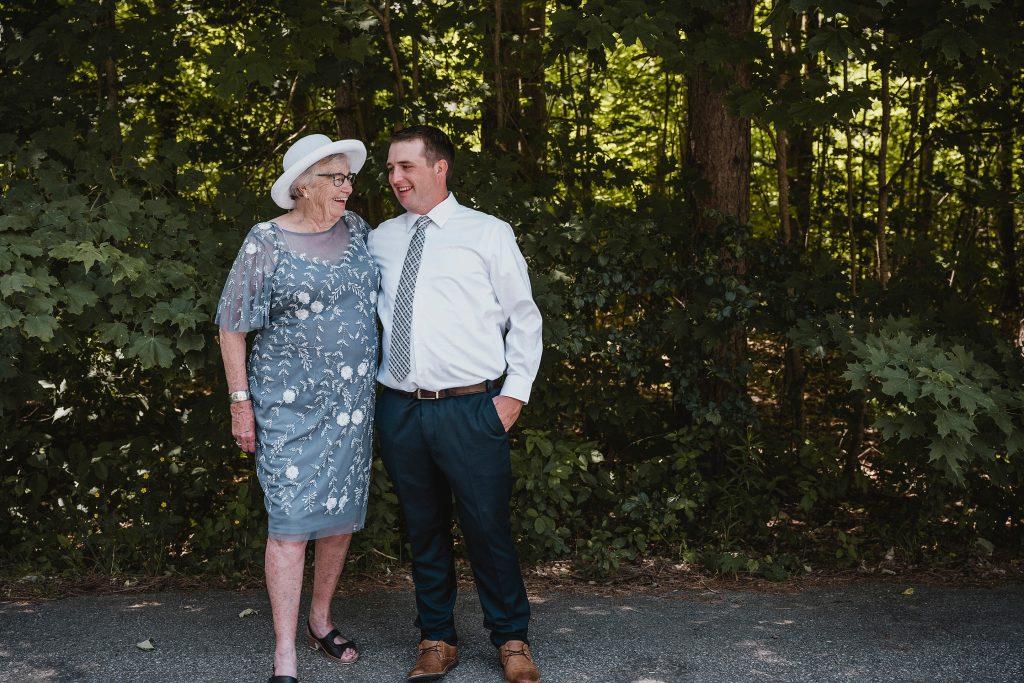groom laughing with grandma