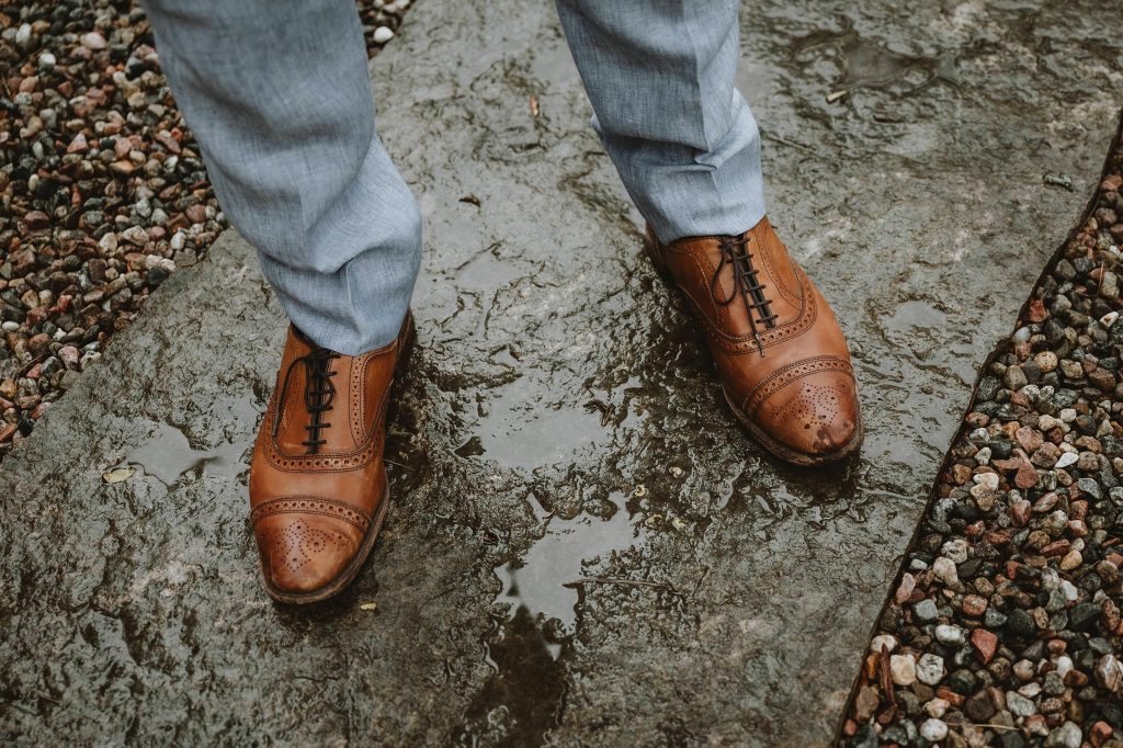 Grooms shoes in the rain