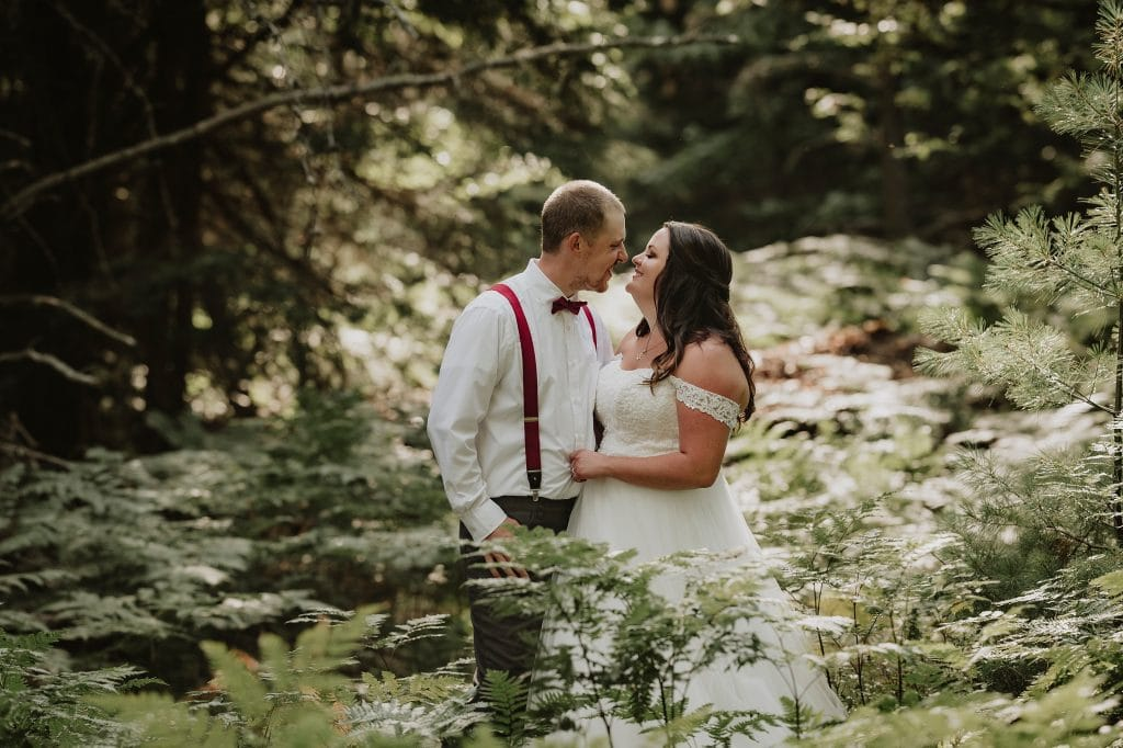 Kazabazua Wedding - bride and groom kiss in the woods