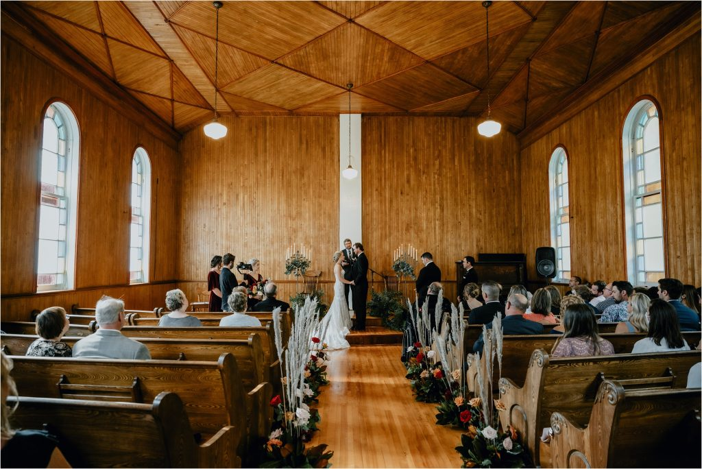 Bride and Groom exchange vows in the small church in Eganville