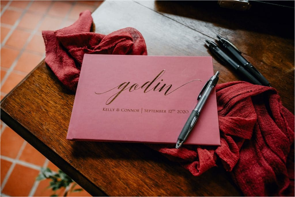 A custom guest book on the wedding day at Grey Gables Inn in Pembroke