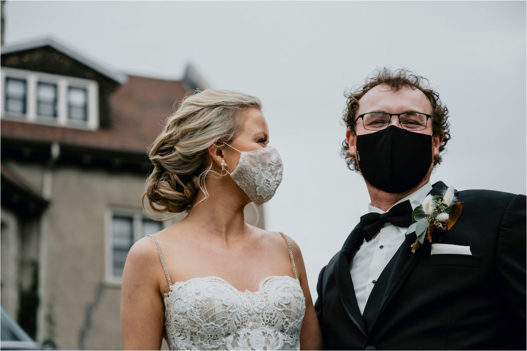 Bride and Groom wearing their masks at their wedding reception at Grey Gables Inn in Pembroke