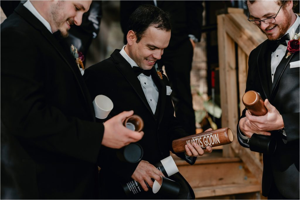 Groomsmen opening gifts from the groom - custom canteens