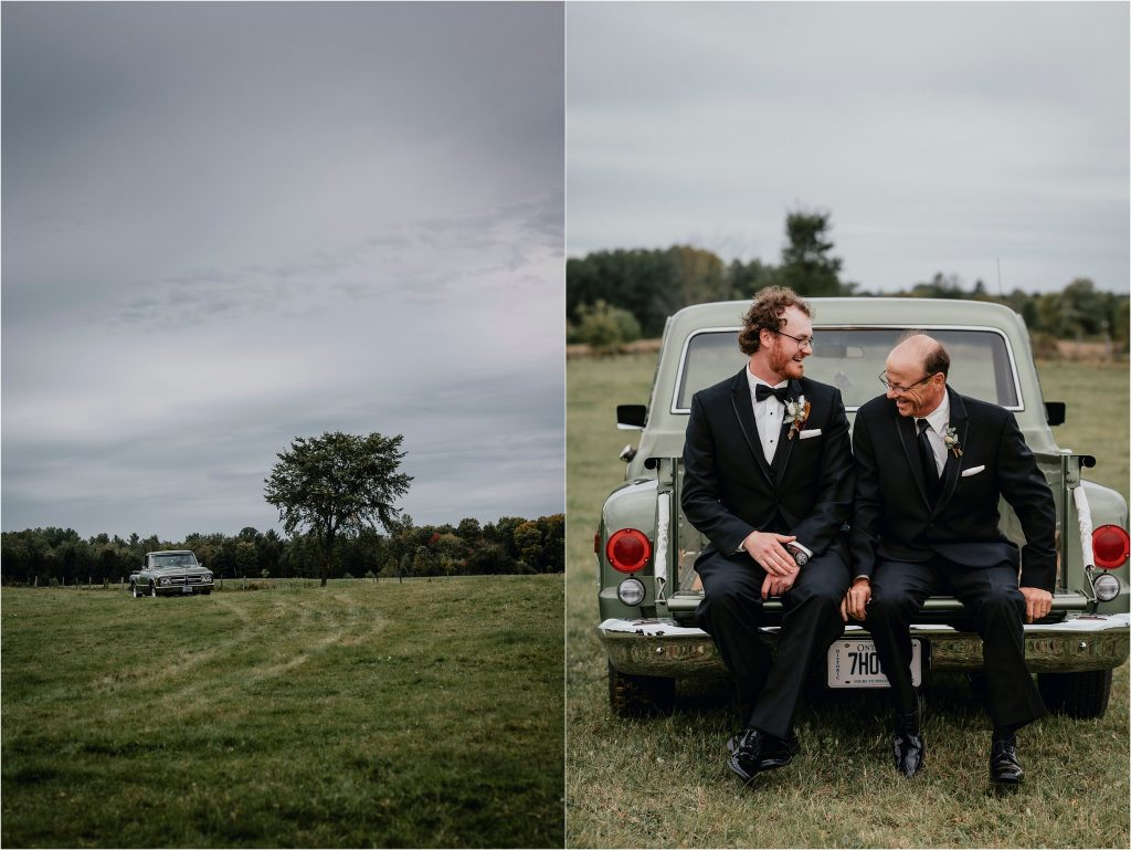 Groom and his dad sitting on the back of a vintage pickup truck in Pembroke