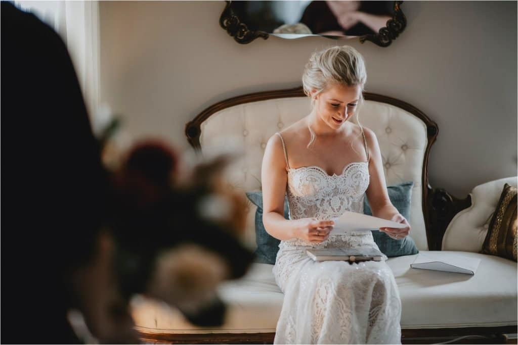 Bride reading a letter from the groom at Grey Gables Inn in Pembroke