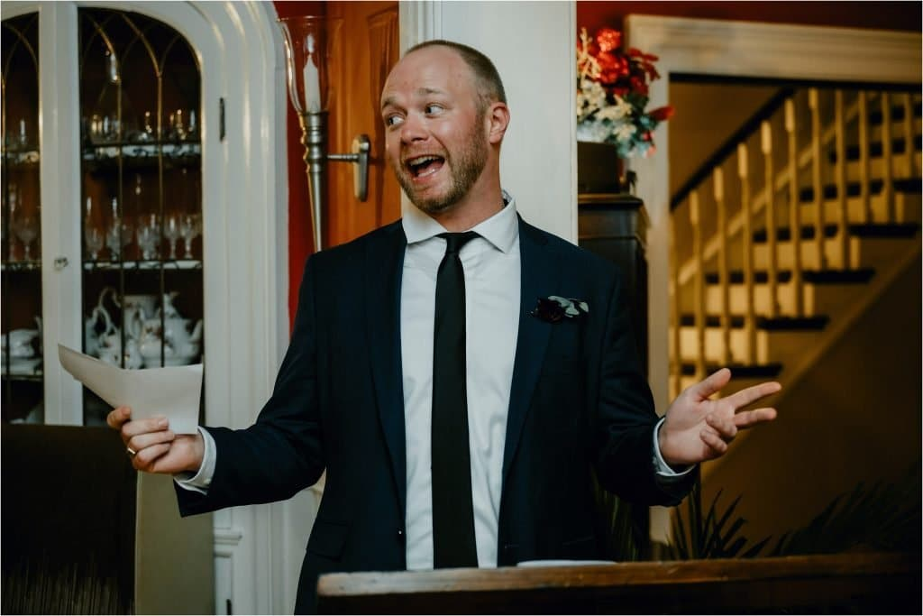 the MC laughs at a wedding reception at Grey Gables Inn in Pembroke