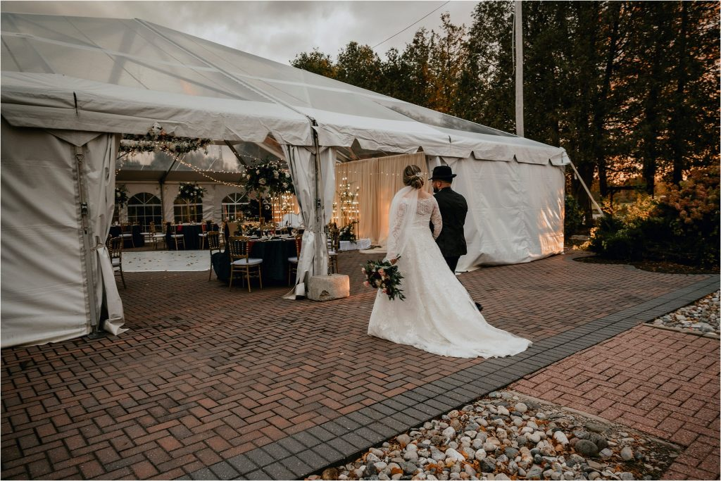 Bride and groom enter their wedding tent at Orchard View