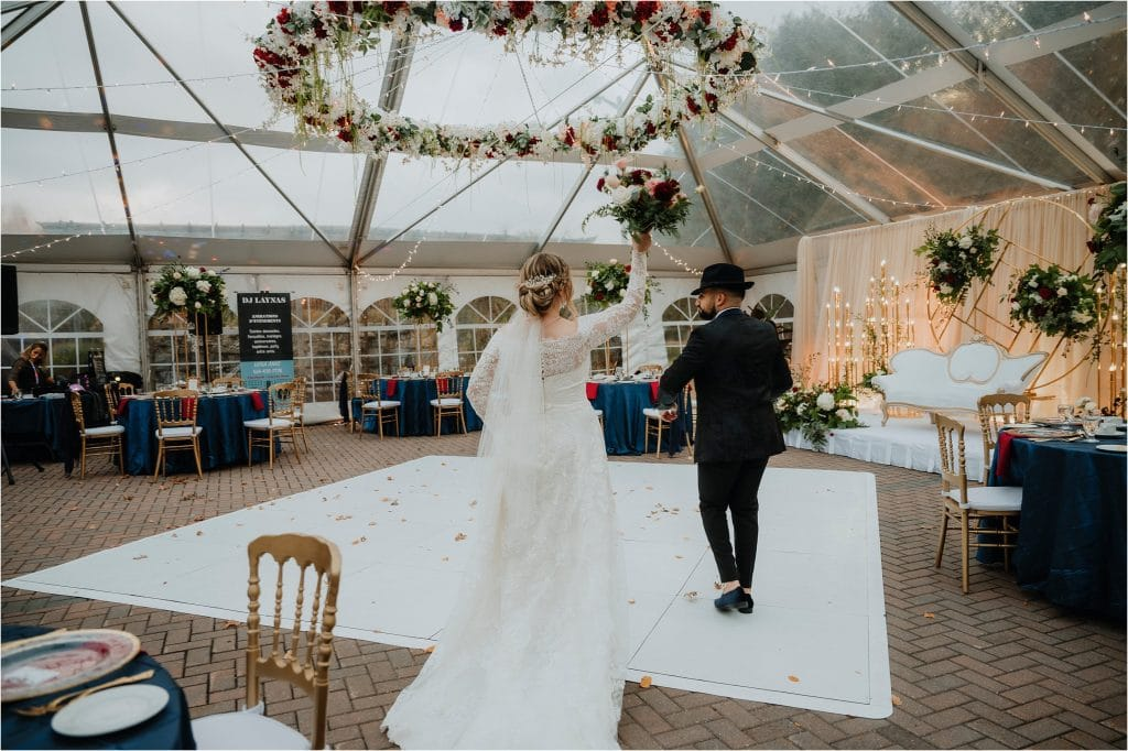 Bride and Groom dance into their wedding tent