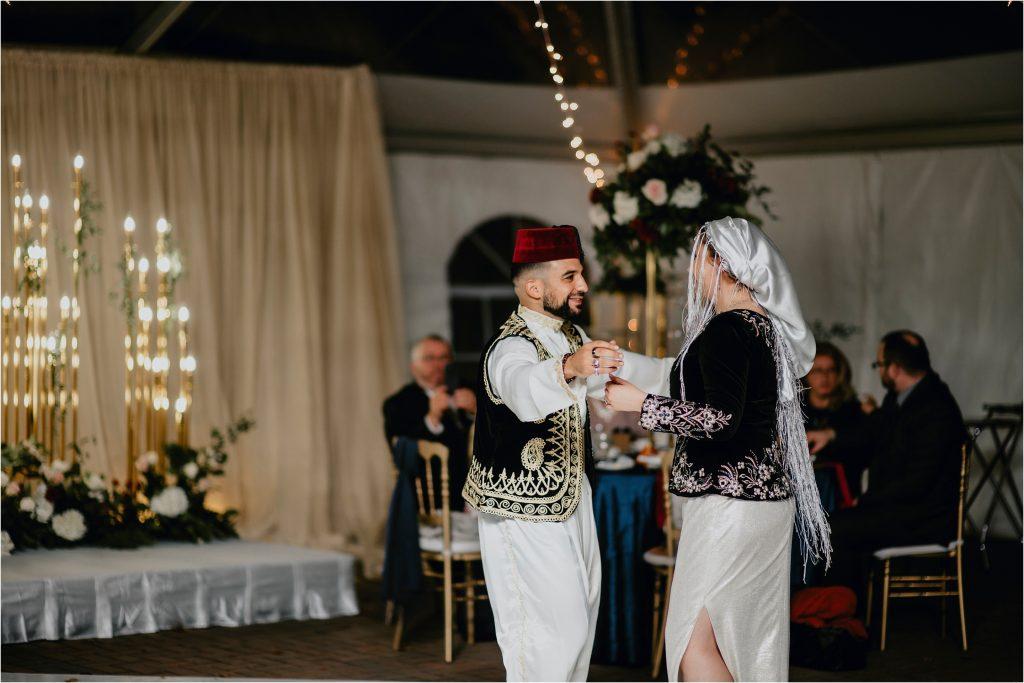 groom and bride dance in traditional Algerian wedding attire