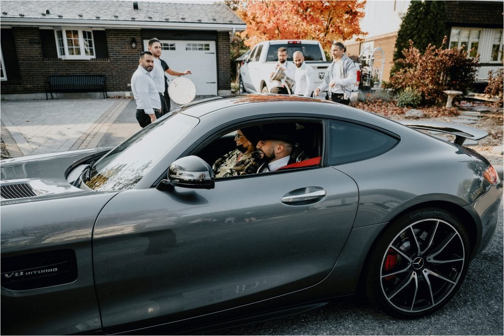 groom pulls up to bride's house in a Mercedes sport car.