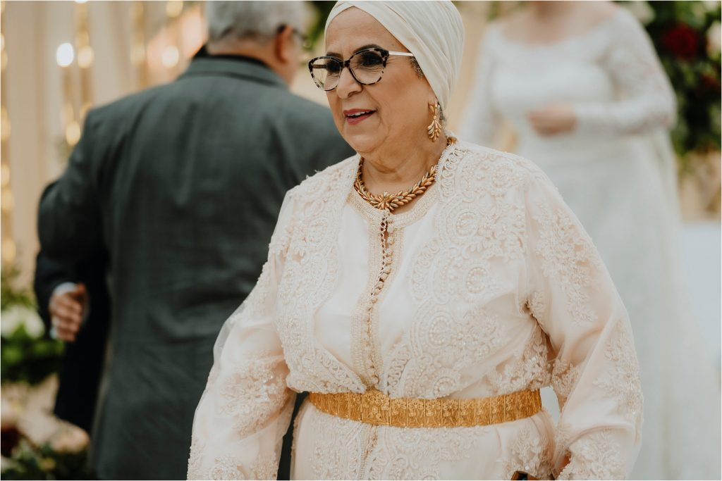 mother of the groom enters the tent in traditional Algerian dress