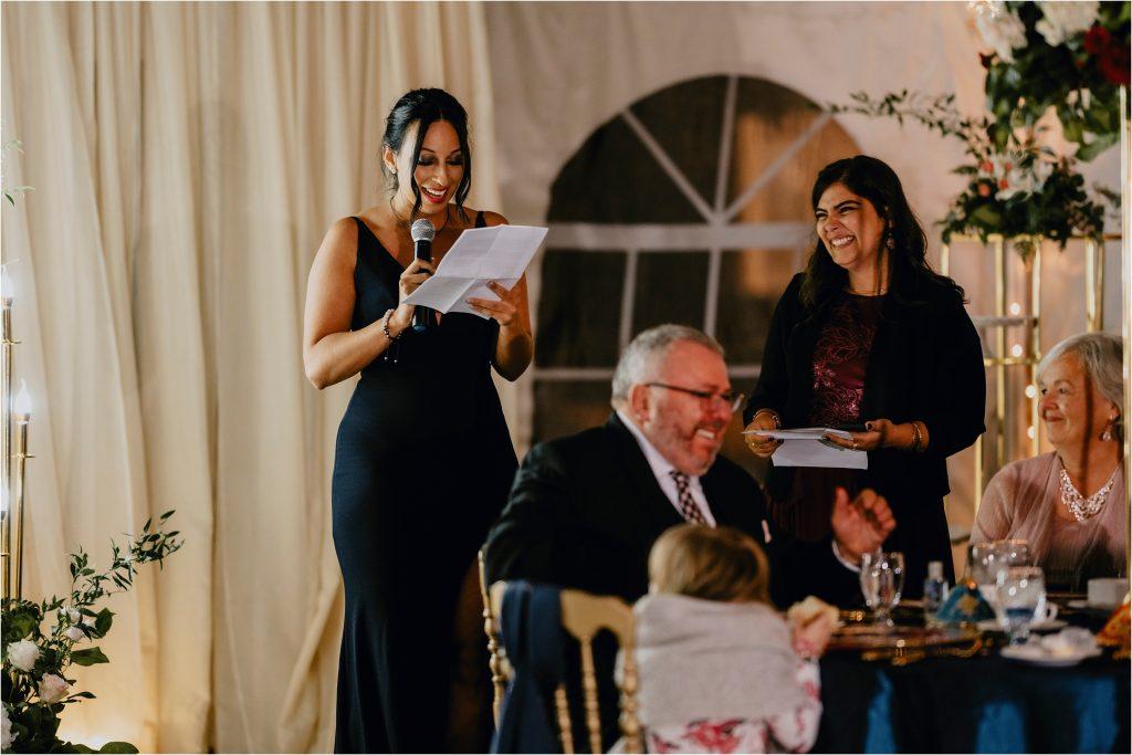 bridesmaid gives a speech at a wedding