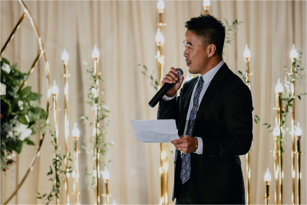 friend of the groom giving a speech at orchard view wedding