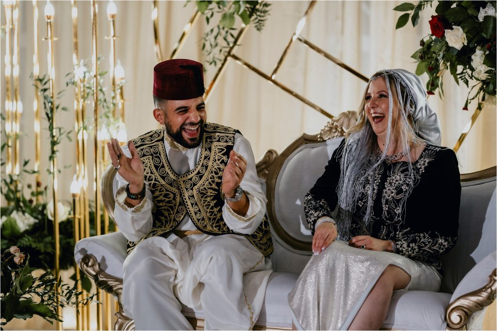 bride and groom react with big laughs to a speech at their orchard view wedding