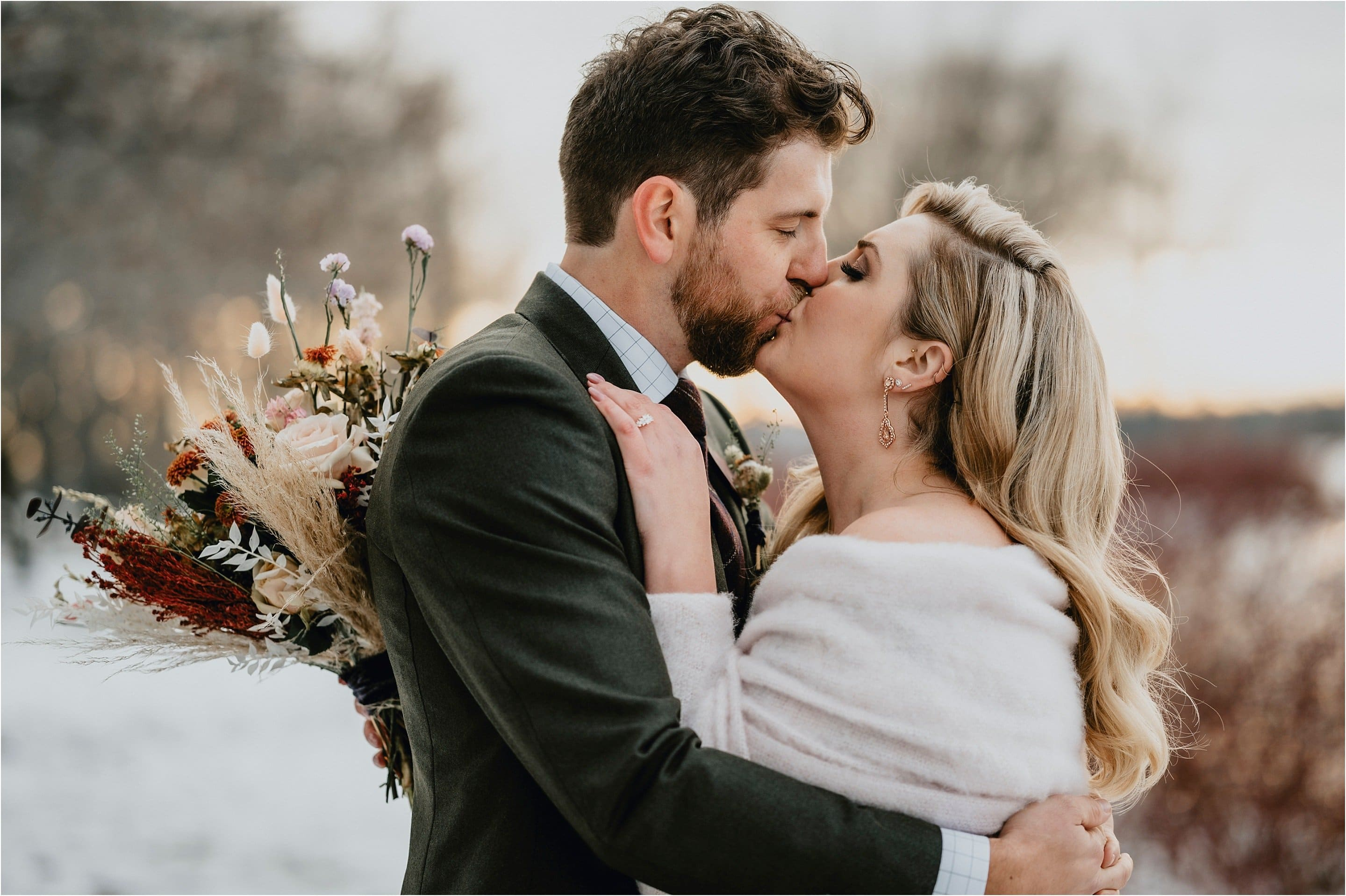 Hotel Grand Wedding - Bride and Groom kiss on a winter day