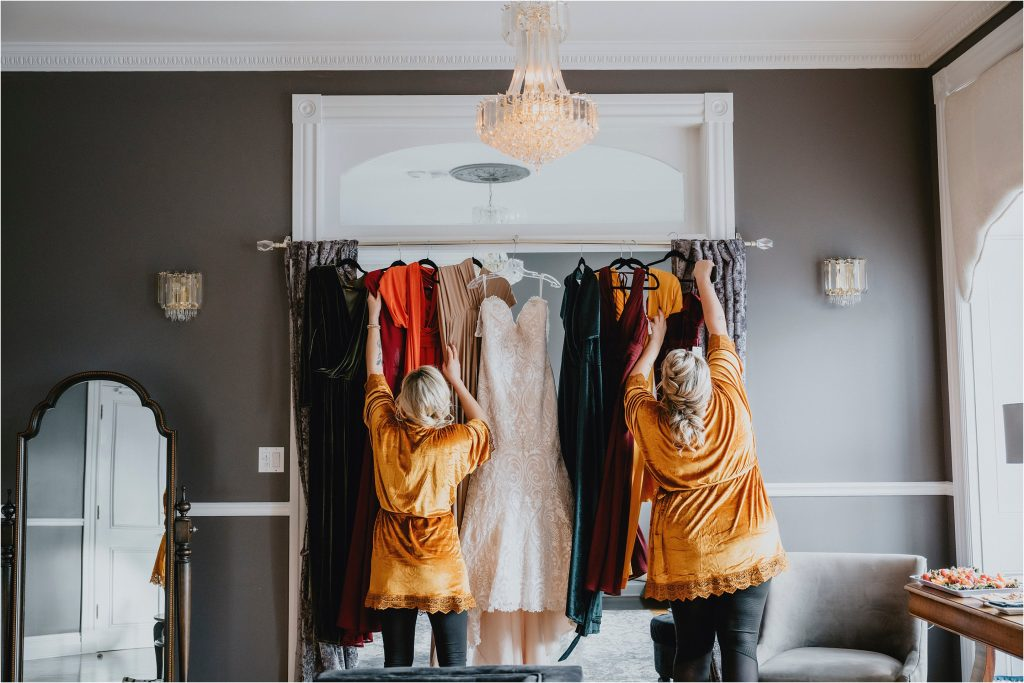 the grand hotel carleton place - bridesmaids grab their hanging dresses