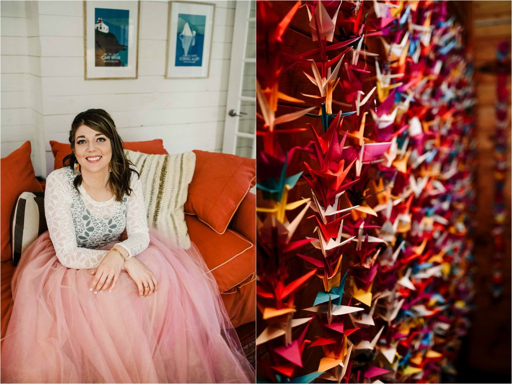 A rad bride wearing a pink chiffon skirt sits on an orange couch for a wedding portrait.