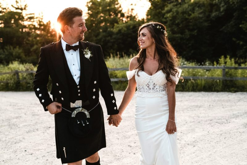 Couple holds hands at Le Belvedere at their Summer Wedding