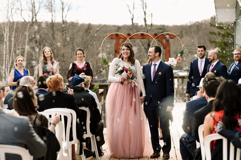 Guests blow bubbles for an epic wedding ceremony exit down the aisle.