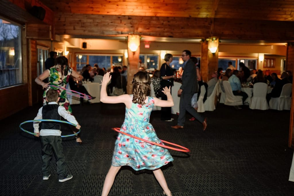 A fun wedding reception at Camp Fortune showing kids hula-hooping on the dance floor.